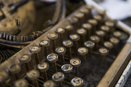 79e7241a6a9 Close up view on an old dirty broken antique typewriter machine keys with  Cyrillic symbols letters