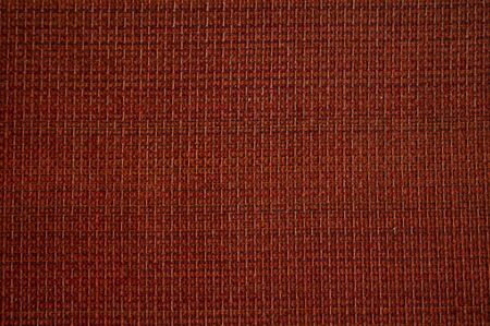 Red fabric textile texture in red color.