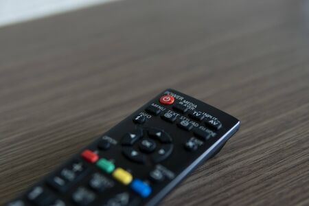 Close up on a remote controller on a table