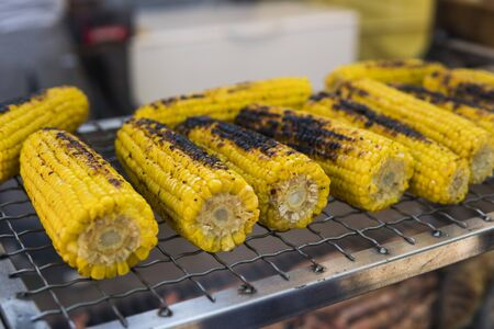 Grilled vegetable on fire. Grilled yellow corn.