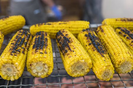 Grilled vegetable on fire. Grilled yellow corn Stock fotó