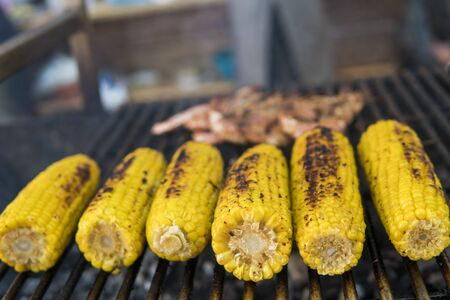 Appetizing grilled shrimps and corn on a food fest. Sea food and vegetables Stock fotó