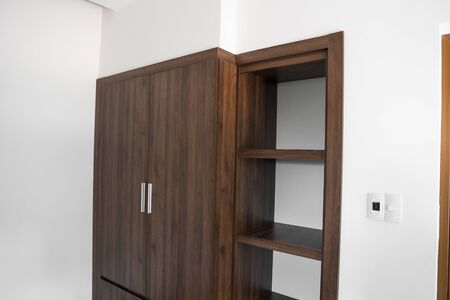 Modern brown wooden wardrobe in the room. Stok Fotoğraf