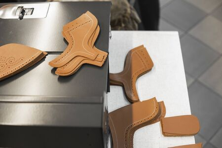 Different forms of leather pieces which will be use for making a shoes on a shoes factory. Prepared, bundled leather parts, used in the production of shoes