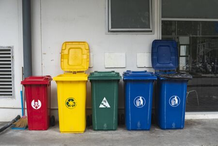 Garbage Trash Bins for collecting a recycle materials. Garbage trash bins for waste segregation. Separate waste collection food waste, plastic, paper and danger waste. Recycling. Environment Reklamní fotografie