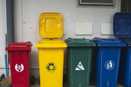 Garbage Trash Bins for collecting a recycle materials. Garbage trash bins for waste segregation. Separate waste collection food waste, plastic, paper and danger waste. Recycling. Environment