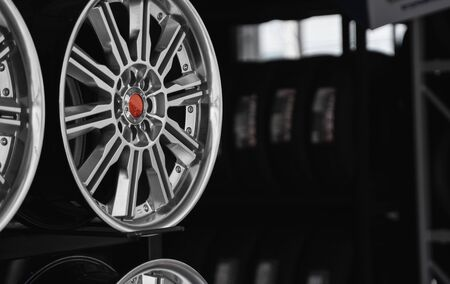 ar drives in the store with black background. Chrome car wheels for sale