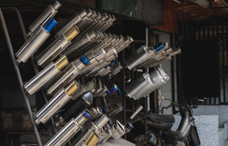 New and used motorcycle exhaust chrome pipes in a motorcykles shop or in service center