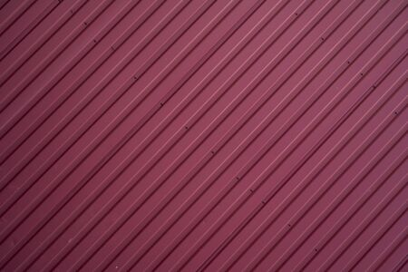 Red Corrugated metal sheet texture surface of the wall. Galvanize steel background