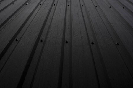 Black Corrugated metal sheet texture surface of the wall. Galvanize steel background 版權商用圖片