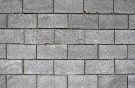 Lightweight concrete block foamed texture. Background texture of white Lightweight Concrete block, raw material for industrial or house wall. Imagens