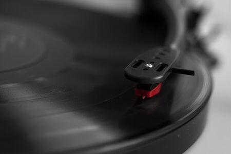 Vinyl turntable on a white background. Retro audio equipment for vinyl disk.