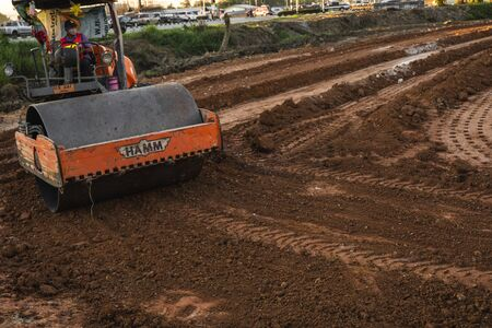 VIETNAM, HO CHI MINH - May 15, 2019: Road rollers working on the new roads construction site. Heavy duty machinery working on highway. Construction equipment. Compaction of the road.