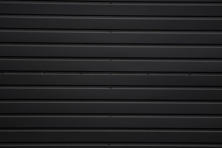 Black Corrugated metal sheet texture surface of the wall. Galvanize steel background.