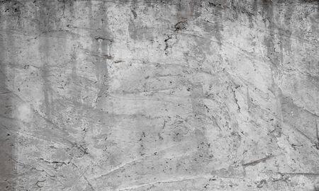 Texture del vecchio muro di cemento per lo sfondo. Fondo bianco del muro di cemento con crepe nad fori