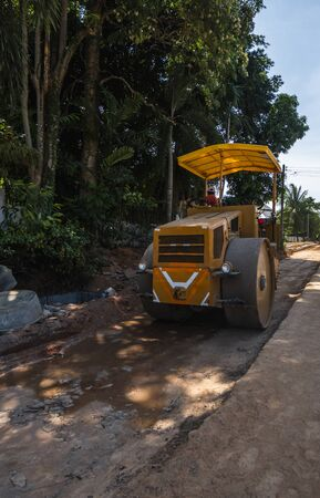 Road rollers working on the new roads construction site. Heavy duty machinery working on highway. Construction equipment. Compaction of the road. 스톡 콘텐츠