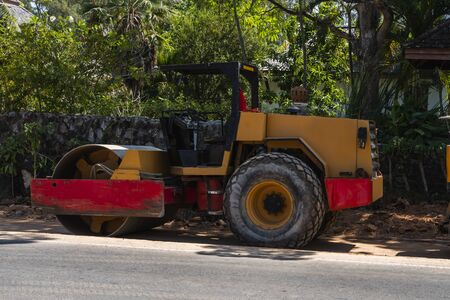 Road rollers working on the new roads construction site. Heavy duty machinery working on highway. Construction equipment. Compaction of the road 스톡 콘텐츠