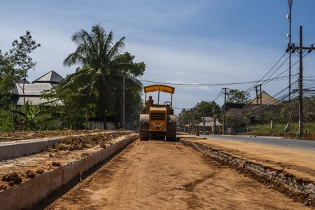THAILAND, PHUKET - December 12, 2018: Road rollers working on the new roads construction site. Heavy duty machinery working on highway. Construction equipment. Compaction of the road. 에디토리얼