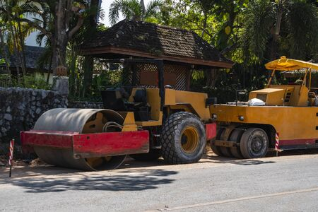 Two road rollers working on the new roads construction site. Heavy duty machinery working on highway. Construction equipment. Compaction of the road