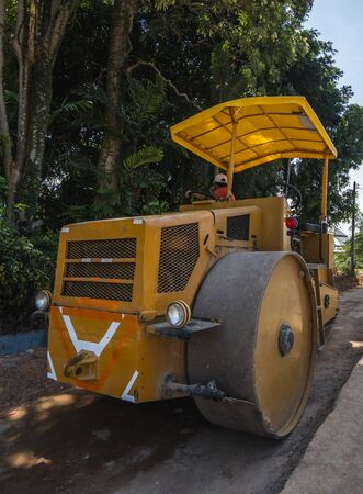 Road rollers working on the new roads construction site. Heavy duty machinery working on highway. Construction equipment. Compaction of the road Banco de Imagens