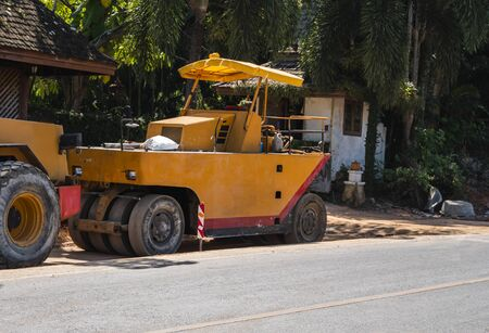 Two road rollers working on the new roads construction site. Heavy duty machinery working on highway. Construction equipment. Compaction of the road. Banco de Imagens