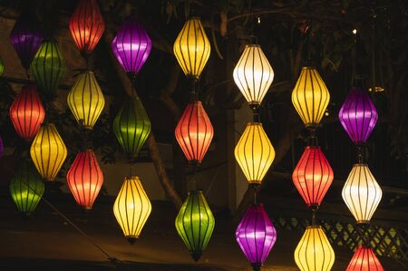 Beautiful decoration lanterns light on night market in Hoi An, Vietnam.