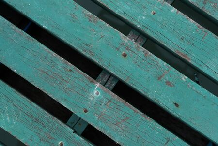 Green painted wooden fence, background or texture.