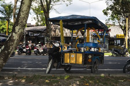 KRABI, THAILAND - JULY 10, 2019. Tuktuk is standing on a road on a street in Krabi. Motorbike taxis are called tuk tuk in Thailand. 新聞圖片