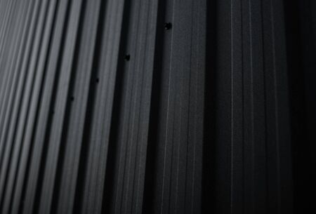 Black Corrugated metal sheet surface of the wall. Galvanize steel background