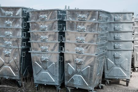 Warehouse of a new silver garbage containers.