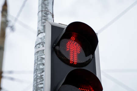 Red trafic light in the city in a daylight.