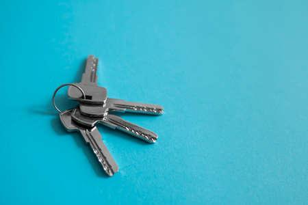 Door keys on blue background. Set of keys. Bunch of keys. House key. New house concept. Rental and Selling.