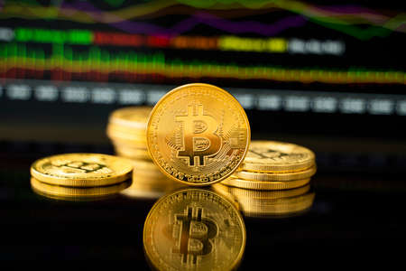 Gold bitcoin coin with a graph chart. Trading on the cryptocurrency exchange. Cryptocurrency Stock Market Concept. Virtual money concept. Mining or blockchain technology.