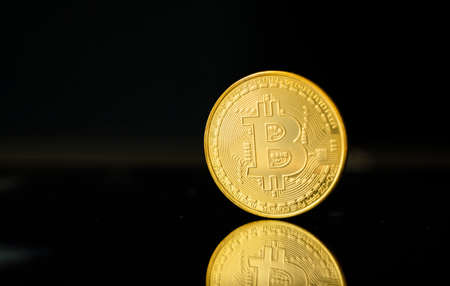 Gold bitcoin coin. Trading on the cryptocurrency exchange. Cryptocurrency Stock Market Concept. Virtual money concept. Mining or blockchain technology.