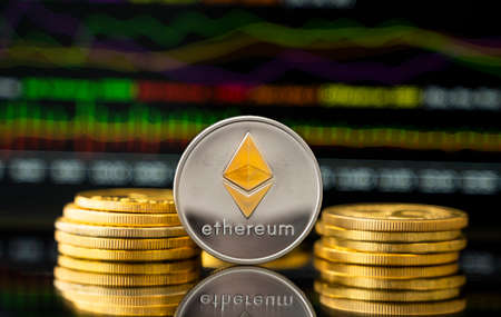 Silver and Gold ethereum coin with a graph chart. Trading on the cryptocurrency exchange. Cryptocurrency Stock Market Concept. Virtual money concept. Mining or blockchain technology.