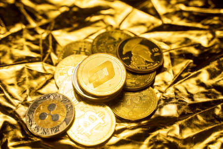 Gold Dash coins on a golden background. Trading on the cryptocurrency exchange. Cryptocurrency Stock Market Concept. Virtual money concept. Mining or blockchain technology. Business concept.