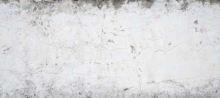 Old grungy grey concrete wall as a texture.