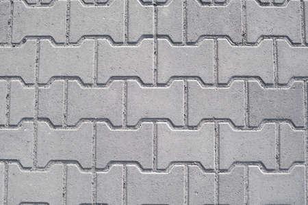 Brick pavement tile, top view. Urban texture as background.