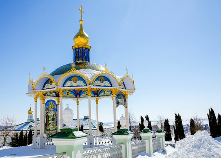 adherent: Summer altar of the Pochaev lavra is in the winter. Stock Photo