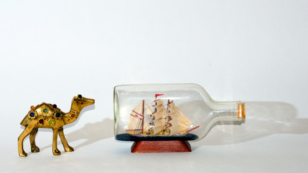 nonsense: Camel after sailing ship collage . Stock Photo