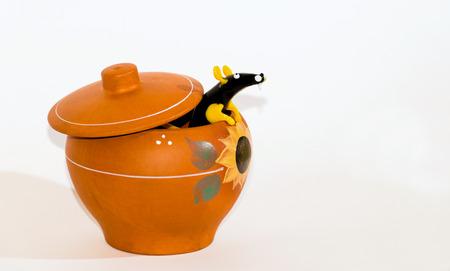 Unsinn: Ratte in Keramiktopf Collage. Lizenzfreie Bilder
