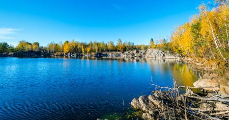 european white birch: Granite delf.  Abandoned Granite Stone Pit is in the autumn.