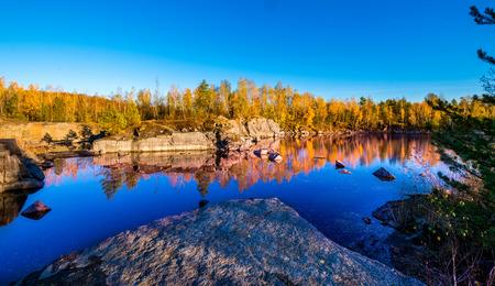 european white birch: Granite open cast.  Abandoned Granite Stone Pit is in the autumn. Stock Photo