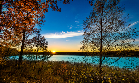 european white birch: Sunset in river water reservoir. The river water reservoir is in the autumn during sunset.