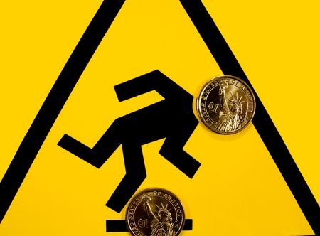 unpredictable: Warning sign. Strike a snag, fall over financial failure. The financial market is unpredictable. Stock Photo