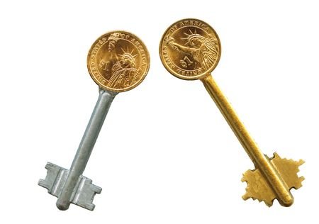 latchkey: American coin latchkey isolated, on white.   Stock Photo