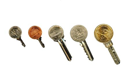 latchkey: An all american coin latchkey isolated, on white.   Stock Photo