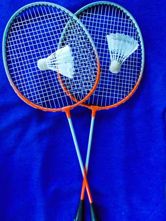 badminton with shuttlecock on blue background