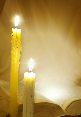 Bible in candle light photo
