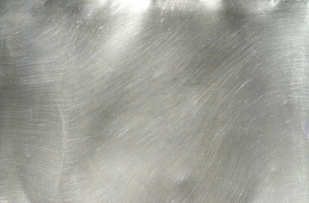 Texture of metal: Brushed Metal texture with lighting and lens ghost.  Stock Photo